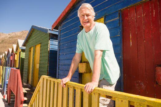 Portrait of man standing at beach hut