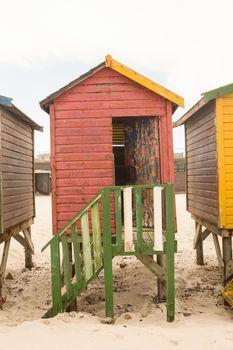 Wooden beach huts on sand