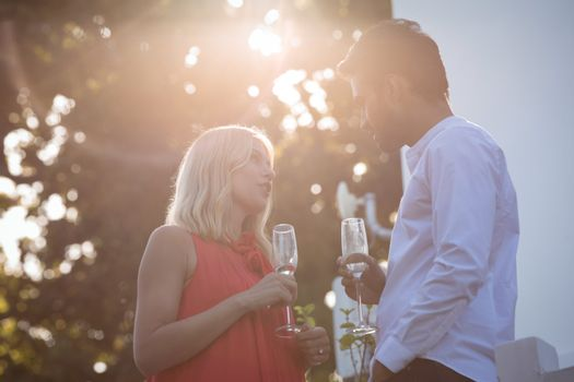 Affectionate couple having champagne in balcony