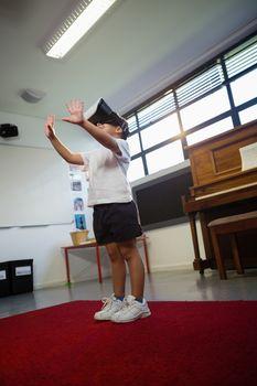 Boy with virtual reality simulator dancing