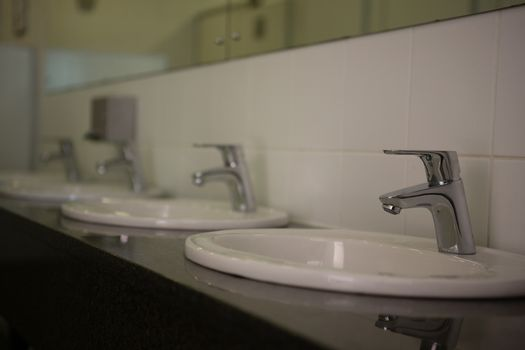 Faucets on sink in bathroom
