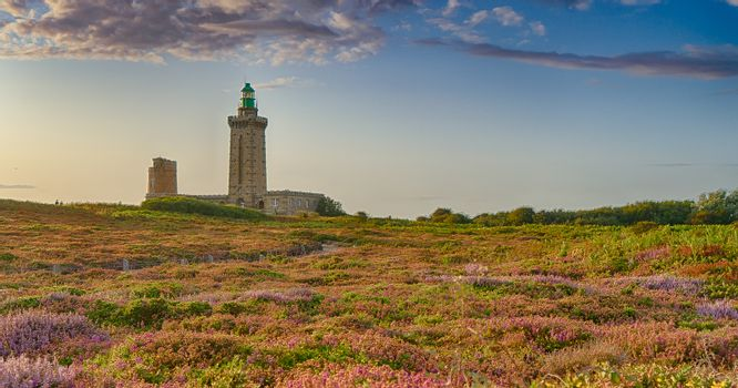 Romantic sunset in France sea coast travel attraction lighthouse