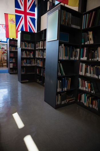 Flags by bookshelf in library