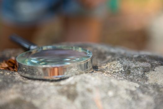 Magnifying glass on the rock