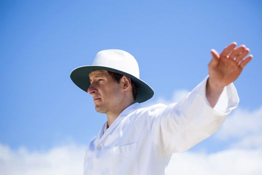 Cricket umpire signalling a boundary