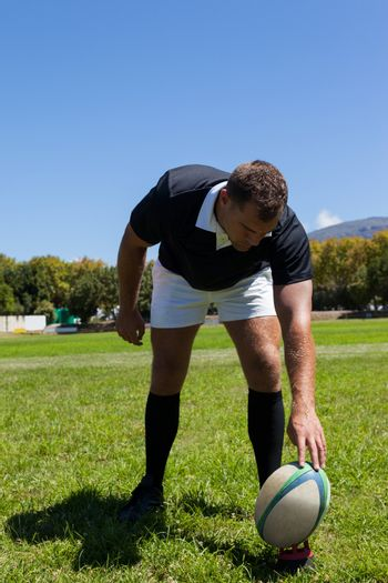 player playing rugby on grassy field
