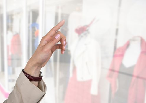 Hand pointing in  air of clothes retail shop