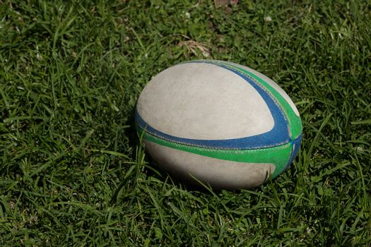 Rugby ball on grassy field