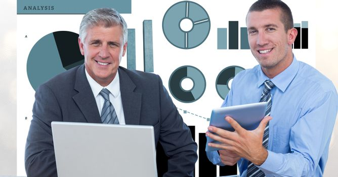 Confident businessmen with technologies and graphs