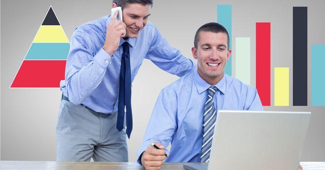 Businessmen using technologies against graphs