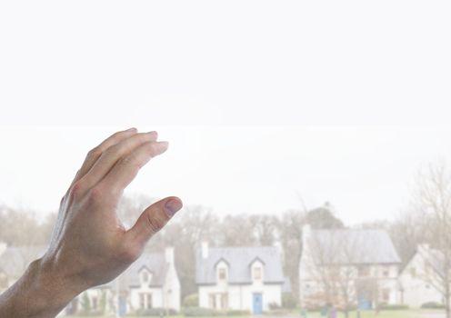 Hand touching  air of housing estate