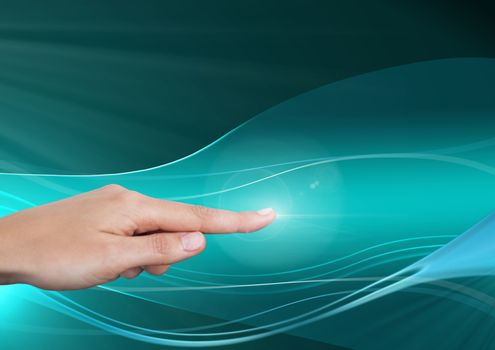 Hand pointing in  air of abstract waves and curves