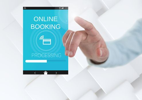 Hand touching an Online Booking App Interface