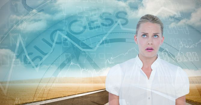 Shocked businesswoman with graphs