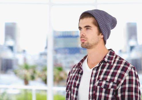 Male hipster wearing knit hat while looking away