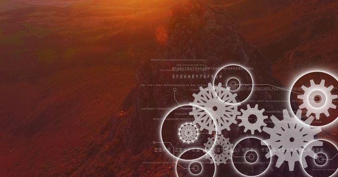 White gear graphics against mountain rock in sunset