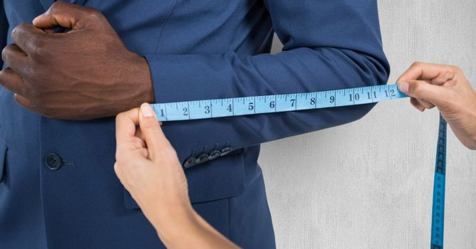 Hand measuring sleeve of businessman