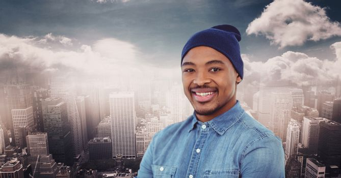 Smiling man wearing knit hat against cityscape