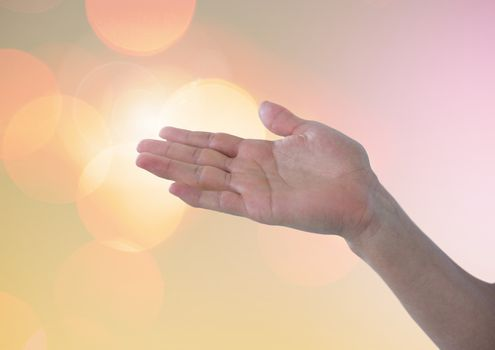 Hand posture with sparkling light bokeh background
