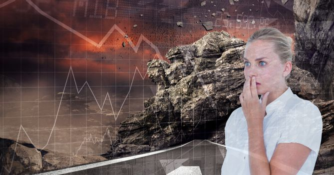 Shocked businesswoman by rocks and graphs