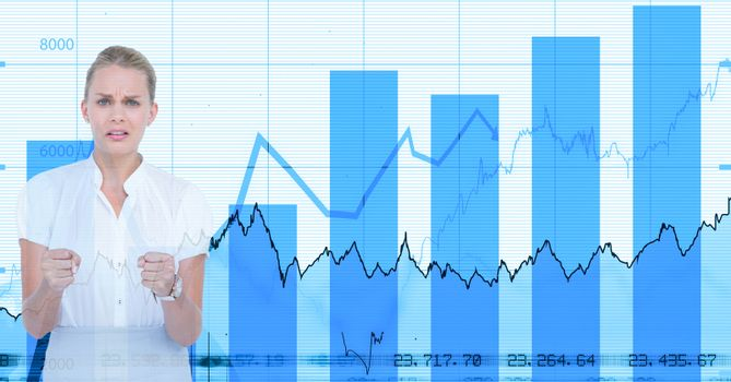 Angry businesswoman standing against graphs