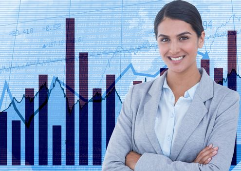 Businesswoman with arms crossed against graphs