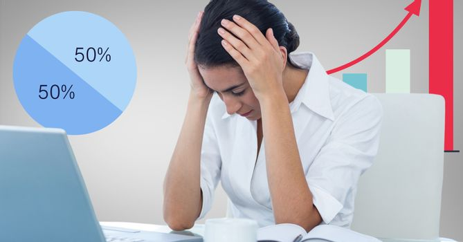 Stressed businesswoman with graphics