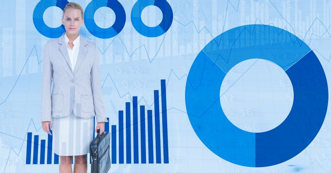 Confident businesswoman against graphs