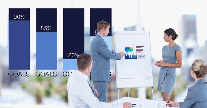 Businessman explaining graphs to colleagues