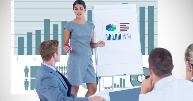 Businesswoman explaining graphs to colleagues