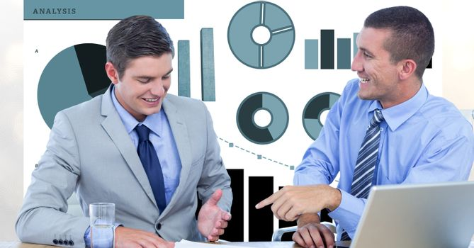 Smiling businessmen discussing against graphs
