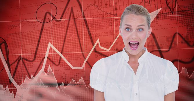 Businesswoman with mouth open against graphs