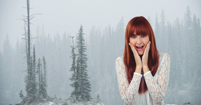 Digital composite of Female hipster with hands on cheeks screaming against trees in foggy weather