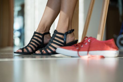 Low section of woman wearing black sandal