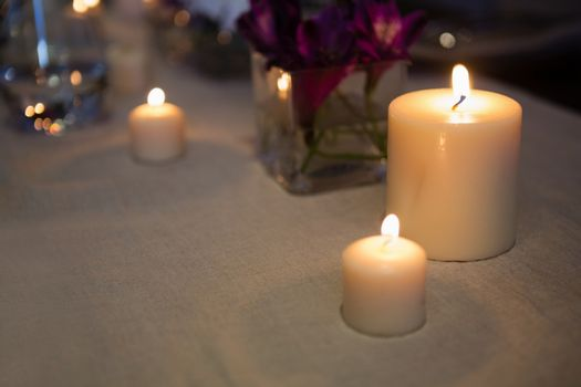 Close up of lit candles on table