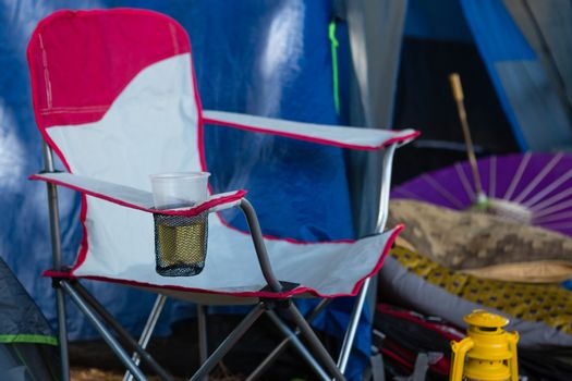 Portable chair with a glass of beer