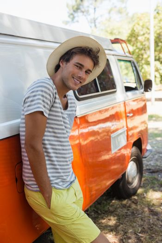 Man leaning on camper van in the park