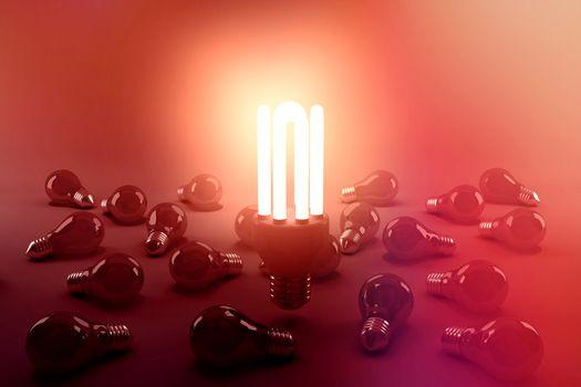 Digital composite image of illuminated energy efficient lightbulb over bulbs