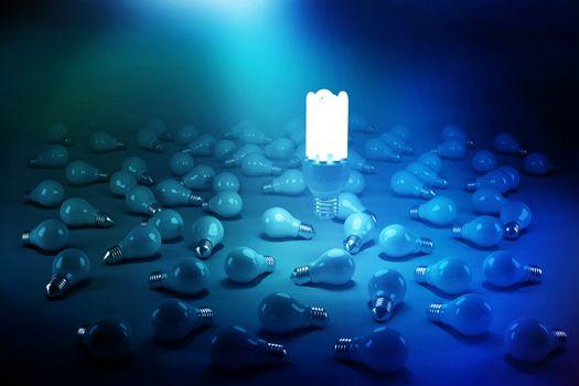 Digitally generated image of lit energy efficient lightbulb over bulbs