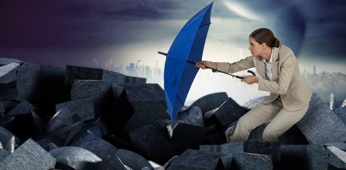 Composite image of full length of businesswoman defending with blue umbrella