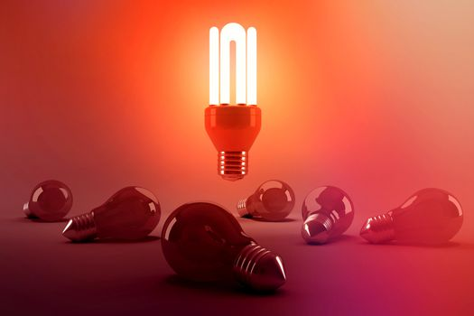 Digitally generated image of illuminated energy efficient lightbulb over bulbs