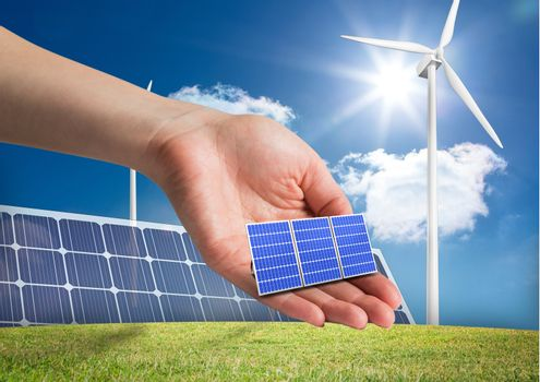 solar panel on hand in front of  different devices to renewable energy