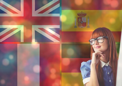 main language flags overlap with color lights around young woman thinking.