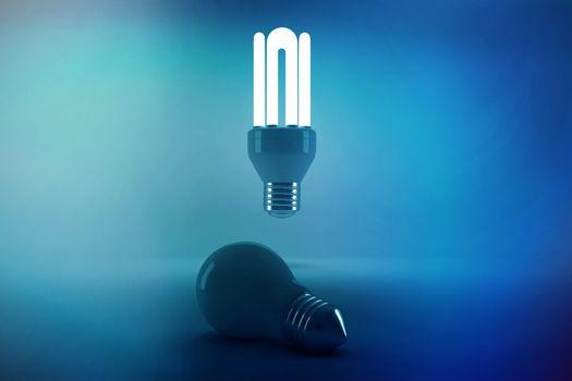 Lit energy efficient lightbulb over bulb
