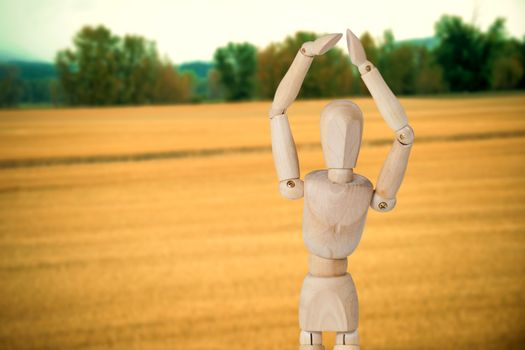 Composite image of wooden 3d figurine standing with hands raised