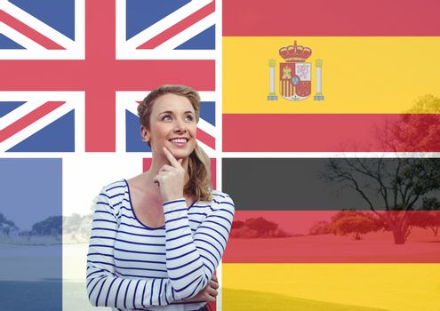 main language flags overlap with field behind young woman imagining