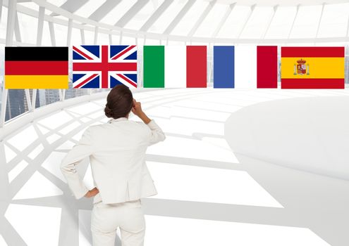 main language flags over businesswoman in the office