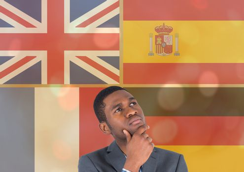 main language flags overlap with gold lights around young man thinking