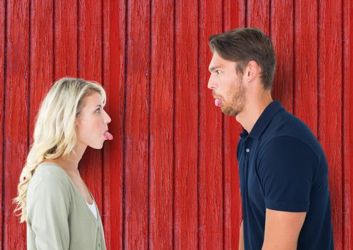 Digital composite of couple funny face each other with red wood background