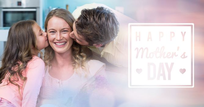 Mum kissed by her husband and her daughter for mother's day